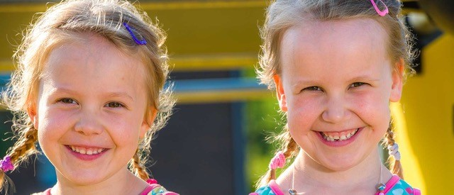 Twins smiling to camera